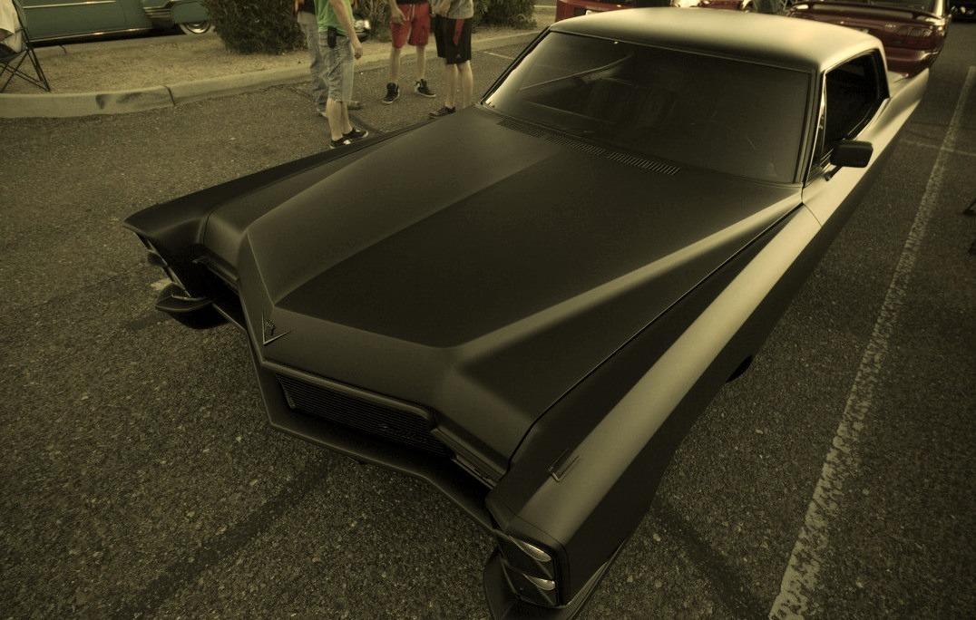 A very black Cadillac